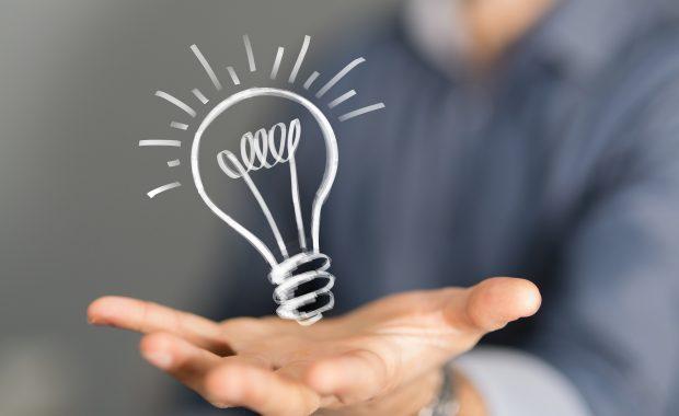 person holding lightbulb idea illustration