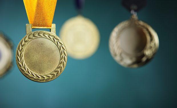 gold medal on teal background
