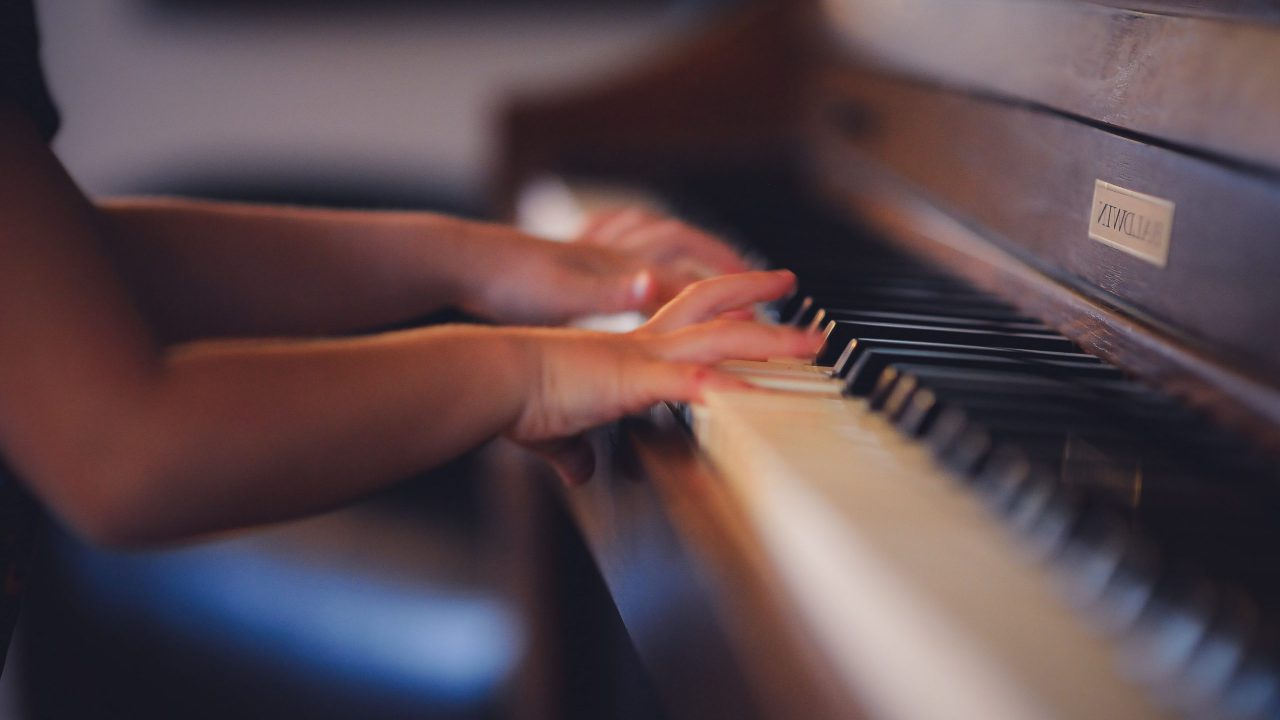 Child hands on piano